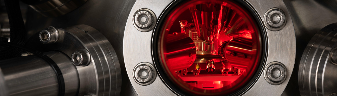 Close-up of equipment with red light on the inside of silver metal